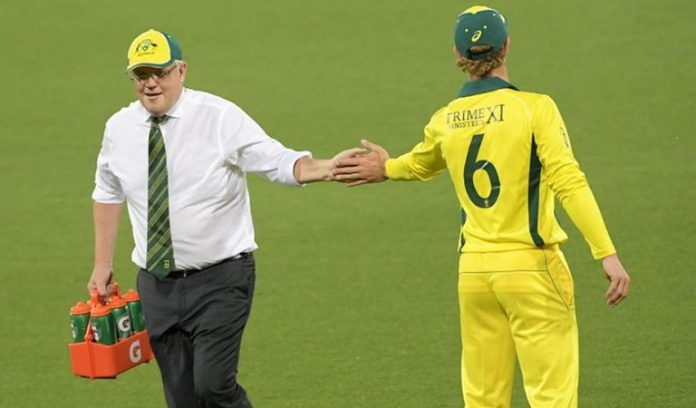Scott-Morrison-served-drinks-during-a-warm-up-match-Australia-vs-sri-lanka